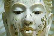 Detail of Gold Leaf. Face of statue at a Buddhist temple.