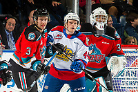 KELOWNA, BC - NOVEMBER 26: Carter Souch #44 of the Edmonton Oil Kings is checked by Sean Comrie #3 ahead of the net of Roman Basran #30 of the Kelowna Rockets  at Prospera Place on November 26, 2019 in Kelowna, Canada. (Photo by Marissa Baecker/Shoot the Breeze)