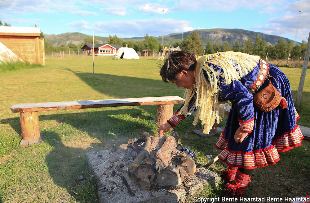"Boazo Sami Siida, a sami camp to visit, just outside the city of Alta. Man dressed in the traditional sami ""kofte"", from the Kautokeino-district of Northern Norway."