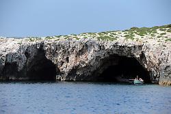 THEMENBILD - Die kroatische Insel Ravnik liegt vor der Küste der Insel Vis. Sie ist unter dem Namen Grüne Grotte bekannt. Sie ist eine Abrasion Höhle mit zwei Eingängen und Öffnung an der Oberseite durch die das Licht eindringen kann und die das Meer in eine magisch grüne Farbe verfärbt. Aufgenommen am 25. August 2013 // THEMES PICTURE - The Croatian island coming aground off the coast of the island of Vis. She is known as the Green Grotto. She is an abrasion cave with two entrances and opening at the top through which light can penetrate and discolor the sea in a magical green color. Pictured on 25th of August 2013. EXPA Pictures © 2013, PhotoCredit: EXPA/ Pixsell/ Dalibor Urukalovic<br /> <br /> ***** ATTENTION - for AUT, SLO, SUI, ITA, FRA only *****