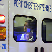 Port Chester, NY 2007 - After being rescued from an apartment building fire by first responders, a woman and young child sit in the back of an ambulance near the scene of the fire at 125 Poningo St. in Port Chester, NY on December 12, 2007. ( Photo by Mike Roy / The Journal News )