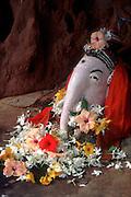 Sri Lanka..Ganesh shrine at the base of a tree, just north of Batticaloa town.