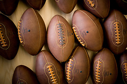 Footballs..Fri Dec 09, 2011: Paul Cunningham is the owner & founder of Leather Head Sports in Glen Rock, NJ - a small business that produces luxury leather footballs, baseballs and medicine balls amongst other leather products. Victor Averos, is an employee primarily responsible for football assembly. .Credit: Rob Bennett for The Wall Street Journal Slug: NYGAY_LemonBall