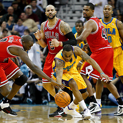 February 12, 2011; New Orleans, LA, USA; New Orleans Hornets guard Marcus Thornton (5) steals the ball from Chicago Bulls small forward Luol Deng (9) during the second quarter at the New Orleans Arena.   Mandatory Credit: Derick E. Hingle