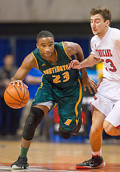 Huntington forward Jeffrey Howard (23) dribbles across mid court against Hurricane during a semi-final game at the Charleston Civic Center.