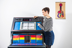 © Licensed to London News Pictures. 05/01/2018. Wakefield UK. Kerry Chase looks at the 2003 piece by Ruth Ewan called 'a jukebox of people trying to change the world' at the new exhibition called Revolt & Revolutions is opening at Yorkshire Sculpture Park, drawn from the arts council collection, it gives an insight into counterculture & anti-establishment movements, and shows the work of artists who seek to make a difference- helping to suggest ways that we might contribute to change on an individual, community & global level. Photo credit: Andrew McCaren/LNP