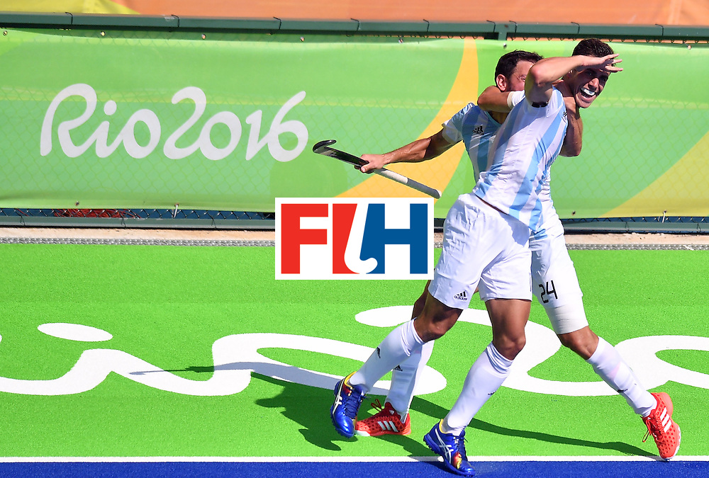 Argentina's Joaquin Menini (R) celebrates a goal with Argentina's Manuel Brunet during the men's semifinal field hockey Argentina vs Germany match of the Rio 2016 Olympics Games at the Olympic Hockey Centre in Rio de Janeiro on August 16, 2016. / AFP / Carl DE SOUZA        (Photo credit should read CARL DE SOUZA/AFP/Getty Images)