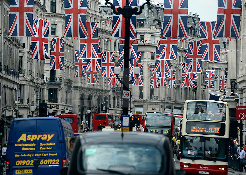 © Licensed to London News Pictures. 30/05/2012. London, UK A view down Regents Street showing traffic  and Union Flag bunting across the street. Preparations today 20th May 2012 around London ahead of The Queen's Diamond Jubilee this weekend. Photo credit : Stephen Simpson/LNP