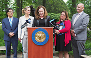 Hempstead, New York, USA. May 30, 2019. At podium, U.S. Representative KATHLEEN RICE (NY-04) holds a press conference to announce she's introducing Three Bills to Congress to combat Impaired and distracted Driving. At left are STEVE CHASSMAN, Executive Director of Long Island Council on Alcoholism & Drug Dependence (LICADD); and Nassau County Executive LAURA CURRAN, and at right are ALISA MCMORRIS, whose son Andrew, a boy scout, was killed by a drunk driver exactly 8 months ago, and RICHARD MALLOW, Executive Director of MADD-New York. Congresswoman Rice announced the package of 3 bills - End Drunk Driving Act, the Prevent Impaired Driving Child Endangerment Act, and the Distracted Driving Education Act of 2019 - at the Drunk Driving Victims Memorial in Eisenhower Park.