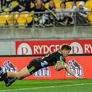 Beauden Barrett dives to score during the Super Rugby union game between Hurricanes and Sunwolves, played at Westpac Stadium, Wellington, New Zealand on 27 April 2018.   Hurricanes won 43-15.