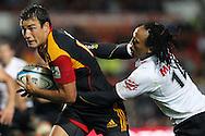 Chiefs' Richard Kahui is caught up by Sharks' Odwa Ndungane. Super 15 rugby union match, Chiefs v Sharks at Waikato Stadium, Hamilton, New Zealand. Friday 18th March 2011. Photo: Anthony Au-Yeung / photosport.co.nz