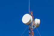 microwave parabolic dish antenna radio link on red and white lattice tower in Capella, Queensland, Australia <br />