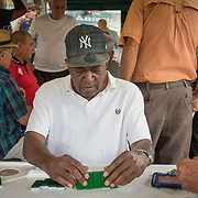 MIAMI, FLORIDA, APRIL 22, 2017<br /> Eduardo Vaillen, 78,  plays  dominoes in Miami's Little Havana neighborhood's Maximo Gomez Domino Park. Many Miami Cubans voted for Donald Trump in the general elections. Trump will soon complete his first 100 days as United States President.<br /> (Photo by Angel Valentin/Freelance)