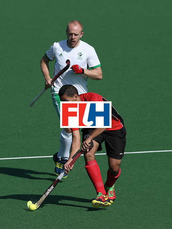 JOHANNESBURG, SOUTH AFRICA - JULY 13: Mohamed Zaki of Egypt controls the ball under pressure from Eugene Magee of Ireland during day 3 of the FIH Hockey World League Semi Finals Pool B match between Ireland and Egypt at Wits University on July 13, 2017 in Johannesburg, South Africa. (Photo by Jan Kruger/Getty Images for FIH)