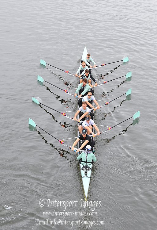 London, United Kingdom.  Friday Morning, Cambridge passing under Hammersmith Bridge.  2014, Varsity, Tideway Week, annual training week, both crews based at Putney, Championship Course,  River Thames;   04:52:44 - Friday  - 04/04/2014  [Mandatory Credit; Intersport Images].<br /> <br /> CUBC. Bow. Mike THORP, 2. Luke JUCKETT, 3. Ivo DAWKINS, 4. Steve DUDEK, 5. Helge GRUETJEN, 6. Matthew JACKSON, 7. Joshua HOOPER, Stroke, Henry HOFFSTOT and cox Ian MIDDLETON 160th Boat Race