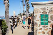 Two Girls Walking on the San Clemente Beach Trail by the Pier