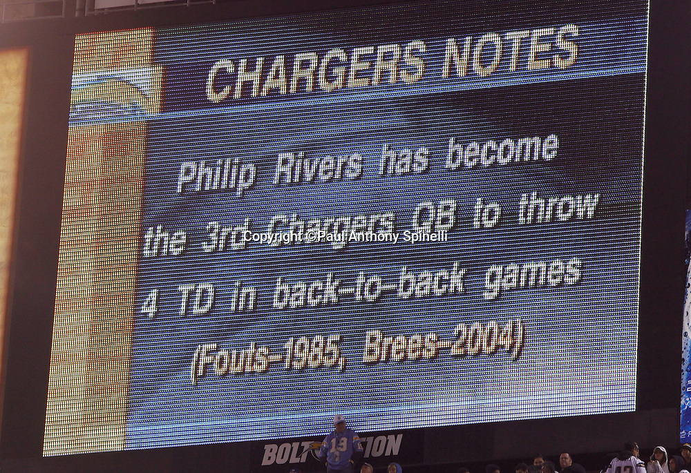 The scoreboard notes that San Diego Chargers quarterback Philip Rivers (17) has become the 3rd Chargers QB to throw four TD's in back-to-back games during the NFL week 11 football game against the Denver Broncos on Monday, November 22, 2010 in San Diego, California. The Chargers won the game 35-14. (©Paul Anthony Spinelli)