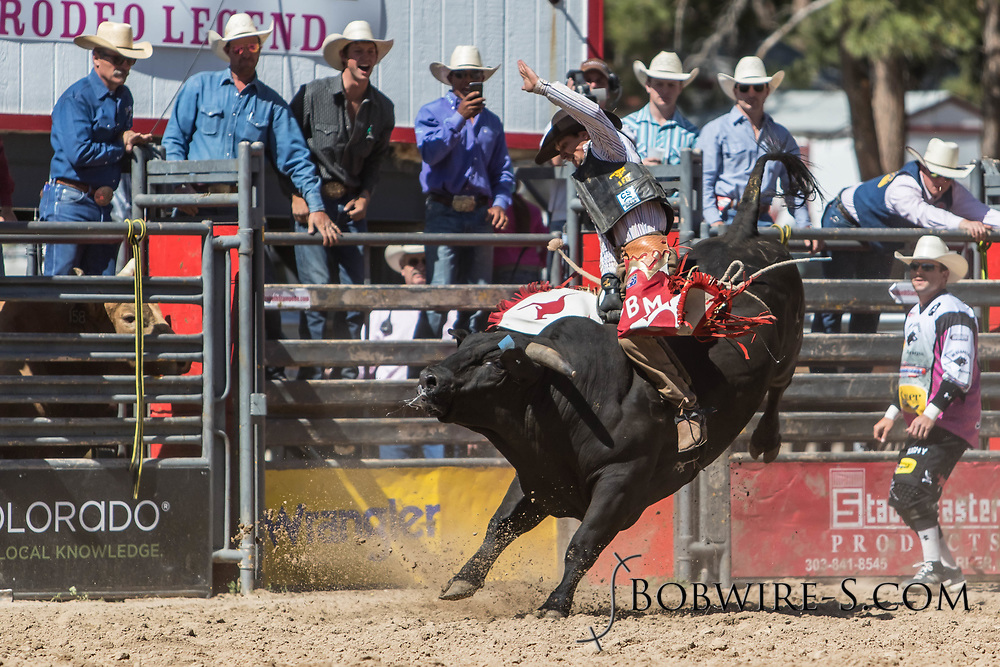 Bull rider Callum Miller rides Salt River Rodeo's 120 Rocky Road in the first performance of the Elizabeth Stampede on Saturday, June 2, 2018.