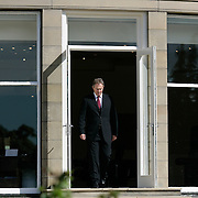 The Prime Minister of the United Kingdom Tony Blair walks out after learning of the London bombings Thursday, July 7, 2005, in Gleneagles, Scotland...Photo by Khue Bui