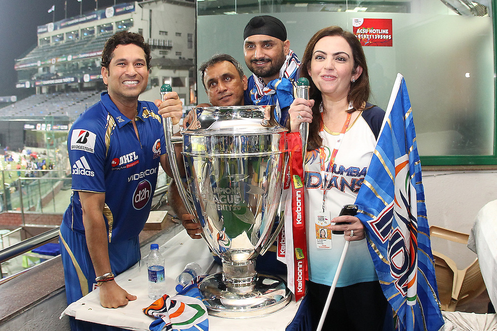 Sachin Tendulkar of Mumbai Indians and Nita Ambani during the Final of the Karbonn Smart Champions League T20 between The Rajasthan Royals and the Mumbai Indians held at the Feroz Shah Kotla Stadium, Delhi on the 6th October 2013<br /> <br /> <br /> Photo by Ron Gaunt-CLT20-SPORTZPICS <br /> <br /> Use of this image is subject to the terms and conditions as outlined by the CLT20. These terms can be found by following this link:<br /> <br /> http://sportzpics.photoshelter.com/image/I0000NmDchxxGVv4