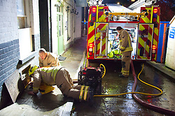 © Licensed to London News Pictures. 26/10/2019. Builth Wells, Powys, Wales, UK. Fire services pump out water from The White Hart Pub following very heavy rainfall for several days, resulting in extremely high river levels of the River Wye and River Irfon, which flood parts of the Welsh market town of Builth Wells in Powys, UK. causing damage to property. Photo credit: Graham M. Lawrence/LNP