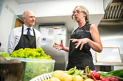 Pictured: Centre manager Lynn Nimmo explained the background to the centre to Joe FitzPatrick<br /> <br /> New Public Health Minister Joe FitzPatrick visited Bridgend Inspiring Growth centre, Bridgend Farmhouse in Edinburgh to launch the Scottish Government's diet and healthy weight delivery plan. <br /> <br /> Mr FitzPartick joined volunteers to prepare some salad for today's lunch.<br /> <br /> Ger Harley | EEm Date