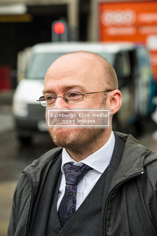 Pictured: Patrick Harvie<br /> <br /> Scottish Green Party co-convener Patrick Harvie and Scottish Greens infrastructure and transport spokeswoman Sarah Beattie-Smith met bus travellers at a busy intersection in Edinburgh as part of the party's Better Bus campaign <br /> Ger Harley | EEm 5 April 2016