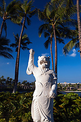 Statue in a garden in front of palm trees Hilton Waikoloa Village, The Big Island, Hawaii, United States of America