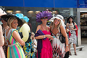 Royal Ascot racegoers From Japan,  at Waterloo station. London. 19 June 2013.