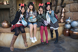 Asia, Japan, Tokyo, DisneySea resort, teenagers wearing Minnie Mouse ears