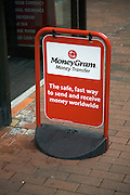 MoneyGram money transfer street advert outside shop