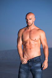 sexy bald shirtless man outdoors