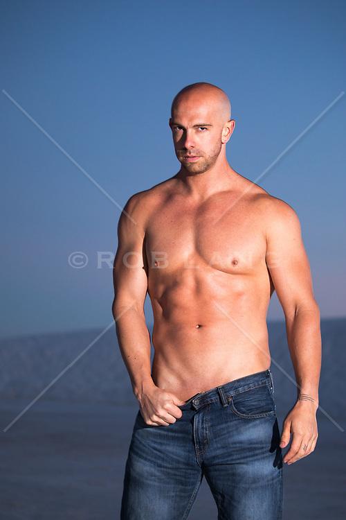 sexy bald shirtless man outdoors