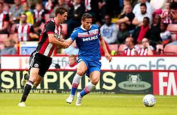 Ramadan Sobhi of Stoke City goes past Chris Basham of Sheffield United - Mandatory by-line: Robbie Stephenson/JMP - 25/07/2017 - FOOTBALL - Bramall Lane - Sheffield, England - Sheffield United v Stoke City - Pre-season friendly