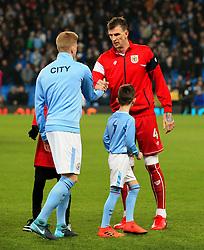 Kevin De Bruyne of Manchester City shakes hands with Aden Flint of Bristol City - Mandatory by-line: Matt McNulty/JMP - 09/01/2018 - FOOTBALL - Etihad Stadium - Manchester, England - Manchester City v Bristol City - Carabao Cup Semi-Final First Leg