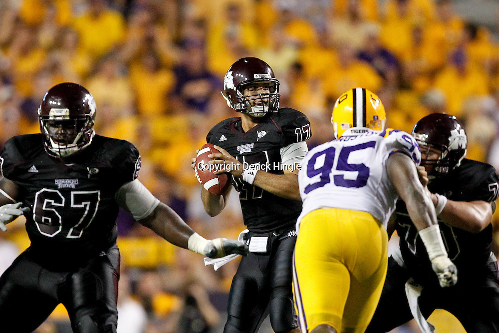 Sep 18, 2010; Baton Rouge, LA, USA;  Mississippi State Bulldogs quarterback Tyler Russell (17) looks to pass during the second half against the LSU Tigers at Tiger Stadium. The LSU Tigers defeated the Mississippi State Bulldogs 29-7. Mandatory Credit: Derick E. Hingle