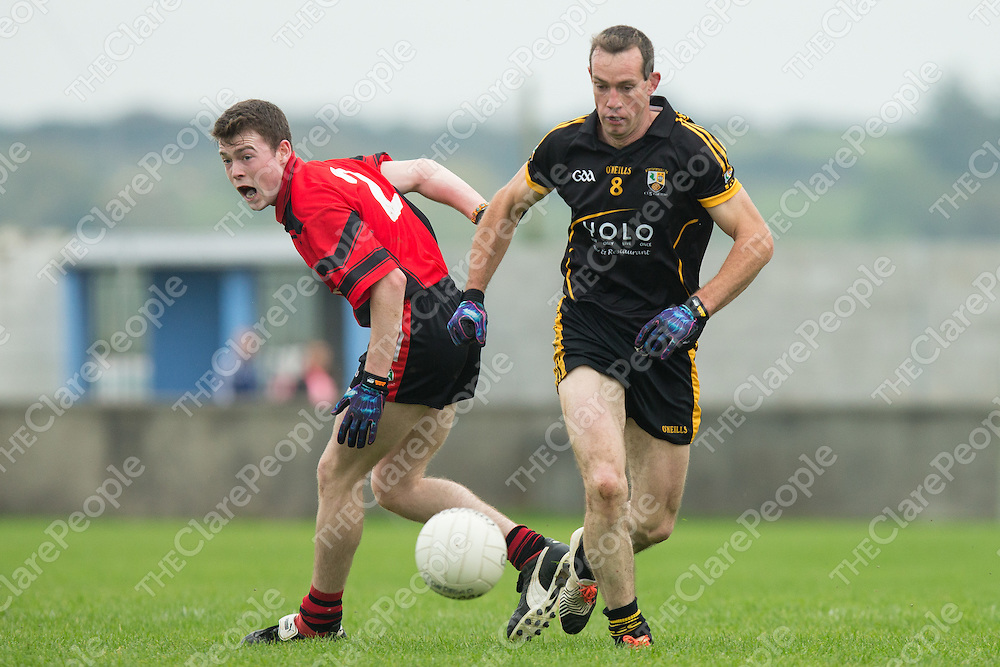 Coolmeen's Noel Meaney side steps Clondegad's Cathal Tighe