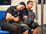 22 OCTOBER 2016 - BANGKOK, THAILAND: A woman and her son, both in mourning clothes, ride the Bangkok subway on their way Sanam Luang to participate in mourning ceremonies. Sanam Luang, the Royal Ceremonial Ground, was packed Saturday with more than 100,000 people mourning the Monarch's death. The King died Oct. 13, 2016. He was 88. His death came after a period of failing health. Bhumibol Adulyadej was born in Cambridge, MA, on 5 December 1927. He was the ninth monarch of Thailand from the Chakri Dynasty and is also known as Rama IX. He became King on June 9, 1946 and served as King of Thailand for 70 years, 126 days. He was, at the time of his death, the world's longest-serving head of state and the longest-reigning monarch in Thai history.       PHOTO BY JACK KURTZ