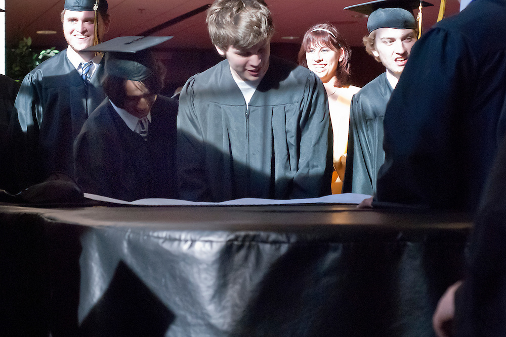 Lathan Goumas   MLive.com..Mike Abbasspour and Alec Campbell play the piano as they wait for the start of the LakeVille Memorial High School commencement ceremony at the Whiting Theater in Flint, Mich. on Wednesday June 6, 2012.