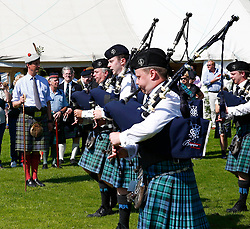 Inveraray Highland Games. Inveraray and District Pipe Band lead the parade from the town centre to the games field at Inveraray Castle. The Duke of Argyll and other dignitaries follow the pipe band to the games field where His Grace officially open the games..His Grace takes the salute before opening the games.... (c) Stephen Lawson | Edinburgh Elite media