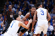 LEXINGTON, KY - DECEMBER 5: Devin Booker #1 and Tyler Ulis #3 of the Kentucky Wildcats defend against Demarcus Holland #2 of the Texas Longhorns during the game at Rupp Arena on December 5, 2014 in Lexington, Kentucky. The Wildcats defeated the Longhorns 63-51. (Photo by Joe Robbins)