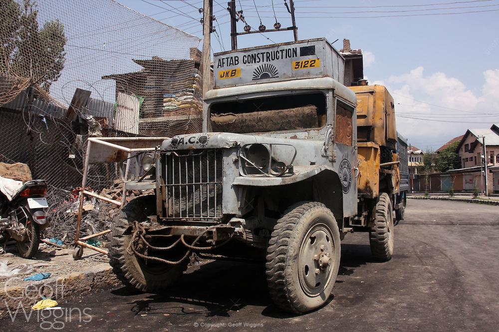 Vintage Nissan 4W73 1 ton truck on a deserted street during civil disturbances in Sringar, Kashmir,  India