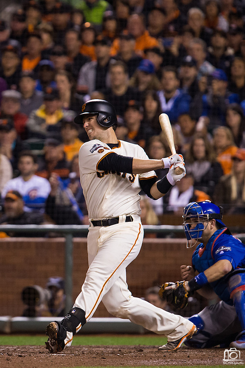 San Francisco Giants catcher Buster Posey (28) connects with a pitch during Game 3 of the NLDS against the Chicago Cubs at AT&T Park in San Francisco, Calif., on October 10, 2016. (Stan Olszewski/Special to S.F. Examiner)