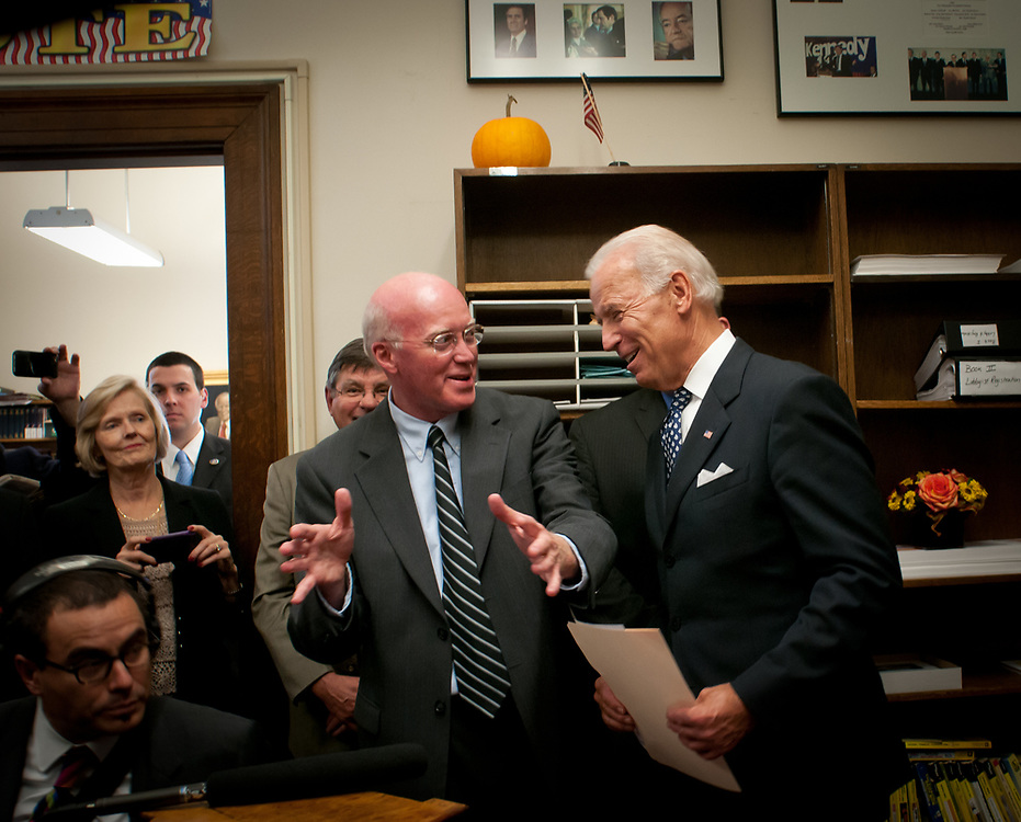VP Joe biden jokes with NH Secretary of State Bill Gardner as Vice President Joe Biden makes a stop at the New Hampshire State house to file official paperwork  with the secretary of state on the president's behalf, making President Obama an official candidate in the New Hampshire primary. Concord, NH. 20th of October 2011