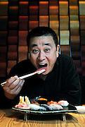 World-renowned Japanese chef Nobu Matsuhisa eats sushi at his restaurant in central Tokyo, Japan. ROB GILHOOLY