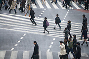 starting to cross at the Hachiko pedestrian crossing in Shibuya Tokyo