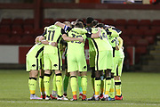 Exeter huddle up before kick off during the EFL Sky Bet League 2 match between Crewe Alexandra and Exeter City at Alexandra Stadium, Crewe, England on 20 February 2018. Picture by Graham Holt.