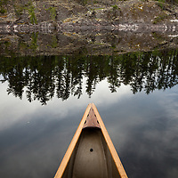 Canoeing Pipestone Bay in the Boundary Waters Canoe Area Wilderness (BWCAW) in Minnesota. The BWCAW is part of Superior National Forest and is under the administration of the U.S. Forest Service. The wilderness area receives about 250,000 visitors each year and is one of the nation's most visited wilderness areas.