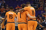 Nov 7, 2014; Phoenix, AZ, USA; Phoenix Suns guard Goran Dragic (1) and forward Markieff Morris (11) hug as they walk off the court in the game against the Sacramento Kings at US Airways Center. The Kings won 114-112 in double overtime. Mandatory Credit: Jennifer Stewart-USA TODAY Sports