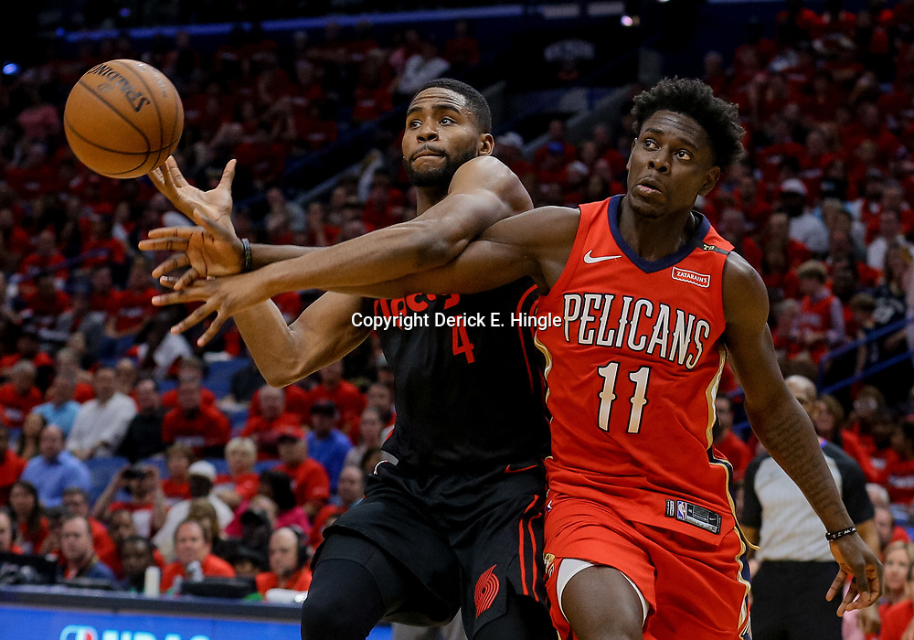 Apr 19, 2018; New Orleans, LA, USA; New Orleans Pelicans guard Jrue Holiday (11) defends against Portland Trail Blazers forward Maurice Harkless (4) during the second half in game three of the first round of the 2018 NBA Playoffs at the Smoothie King Center. The Pelicans defeated the Trail Blazers 119-102.  Mandatory Credit: Derick E. Hingle-USA TODAY Sports